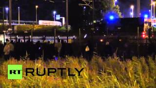 GETLINK SE Police guard Eurotunnel fence as illegal migrants gather