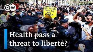 Paris police clash with protesters over COVID 'health pass'   DW News