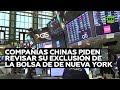 Tras la marcha de Trump tres compañías chinas piden revisar su exclusión de la Bolsa de Nueva York