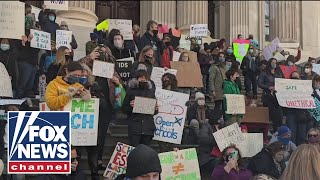 New York City parents sue to fully reopen schools