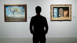 AMP LIMITED Dalí & Magritte: Un coqueteo surrealista