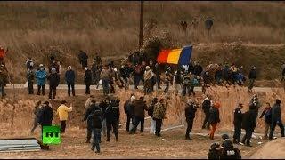 CHEVRON CORP. В Румынии активисты против фрекинга прорвались на территорию энергетической компании Chevron